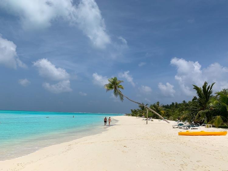 walking on the beach in Maldives